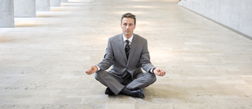 Business man doing meditation pose