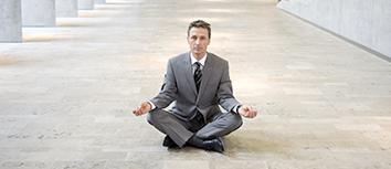 Business man doing meditation pose