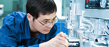 Technician using lab equipment